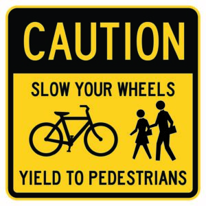 Caution Slow Your Wheels Yield to Pedestrians Sign
