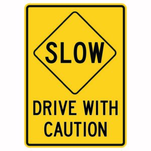 Slow Drive with Caution Sign
