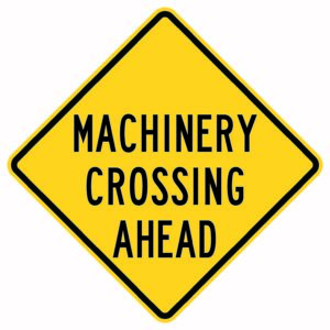 Machinery Crossing Ahead Xing Sign
