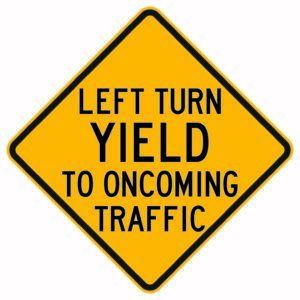 Left Turn Yield to Oncoming Traffic Sign