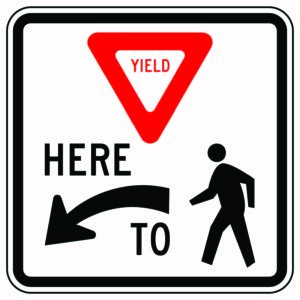 Yield Here to Pedestrian Left Sign