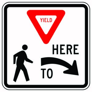 Yield Here to Pedestrian Right Sign