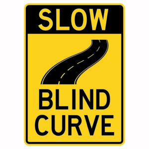 Slow Blind Curve with Road Sign